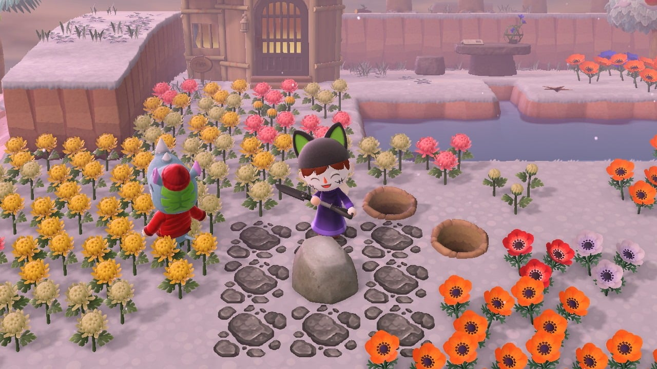 Animal crossing player next to a rock with 2 dug up holes.